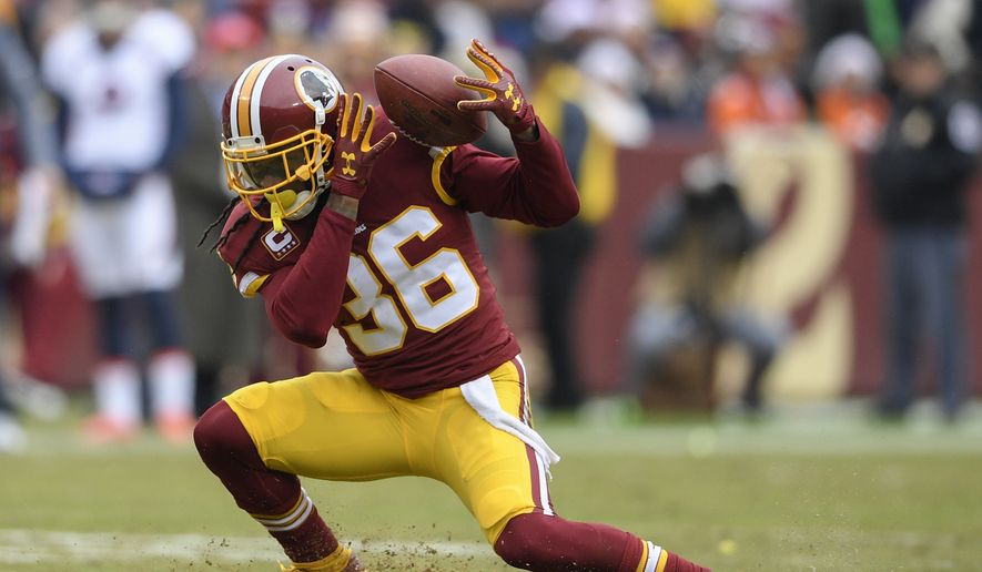 Washington Redskins free safety D.J. Swearinger (36) struggles with a pass reception during the first half an NFL football game against the Denver Broncos in Landover, Md., Sunday, Dec 24, 2017. (AP Photo/Nick Wass) **FILE**