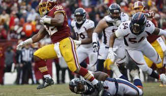 Washington Redskins running back Samaje Perine (32) carries the ball during the second half an NFL football game against the Denver Broncos in Landover, Md., Sunday, Dec 24, 2017. (AP Photo/Alex Brandon)