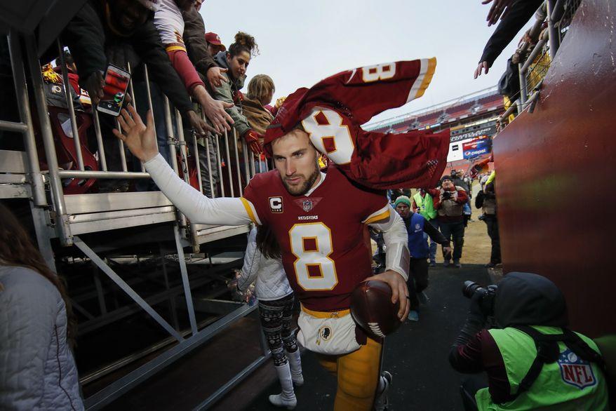 Washington Redskins quarterback Kirk Cousins (8) leaves the field after an NFL football game against the Denver Broncos in Landover, Md., Sunday, Dec 24, 2017. The Redskins defeated the Broncos 27-11. (AP Photo/Alex Brandon)