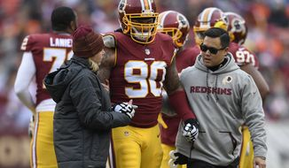 Washington Redskins nose tackle Ziggy Hood (90) is helped from the filed after an injury during the first half an NFL football game against the Denver Broncos in Landover, Md., Sunday, Dec 24, 2017. (AP Photo/Nick Wass)