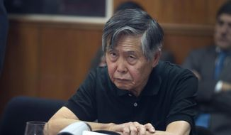 In this Oct. 25, 2013, file photo, Peru's jailed, former President Alberto Fujimori attends his hearing at a police base on the outskirts of Lima, Peru. On Dec. 24, 2017, Peru's President Pedro Pablo Kuczynski announced he was granting Fujimori a medical pardon. (AP Photo/Martin Mejia, File)