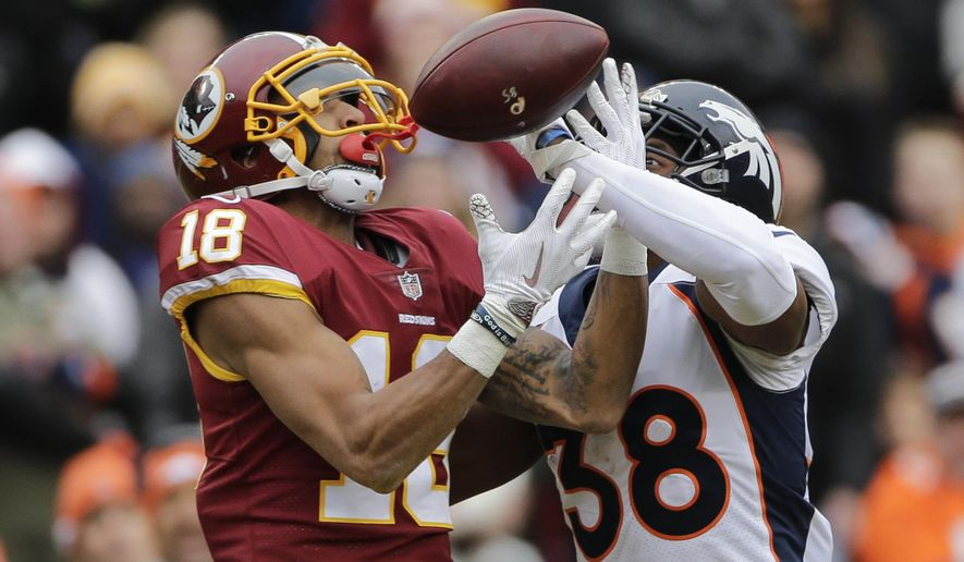 Denver Broncos cornerback Marcus Rios (38) breaks up a pass intended for Washington Redskins wide receiver Josh Doctson (18) during the first half an NFL football game in Landover, Md., Sunday, Dec 24, 2017. (AP Photo/Mark Tenally)