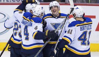 St. Louis Blues' Dmitrij Jaskin, of Russia; Kyle Brodziak; Carl Gunnarsson, of Sweden; Scottie Upshall; and Robert Bortuzzo, from left, celebrate Brodziak's goal against the Vancouver Canucks during the second period of an NHL hockey game Saturday, Dec. 23, 2017, in Vancouver, British Columbia. (Darryl Dyck/The Canadian Press via AP)