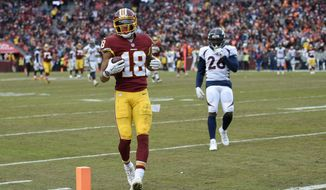 Washington Redskins wide receiver Josh Doctson (18) carries the ball into the end zone for a touchdown during the second half an NFL football game against the Denver Broncos in Landover, Md., Sunday, Dec 24, 2017. (AP Photo/Nick Wass) **FILE**
