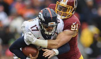 Washington Redskins outside linebacker Ryan Kerrigan (91) sacks Denver Broncos quarterback Brock Osweiler (17) during the second half an NFL football game in Landover, Md., Sunday, Dec 24, 2017. (AP Photo/Nick Wass)