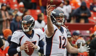 Denver Broncos quarterbacks Brock Osweiler (17) and Paxton Lynch (12) warm up before an NFL football game against the Washington Redskins in Landover, Md., Sunday, Dec 24, 2017. (AP Photo/Alex Brandon)