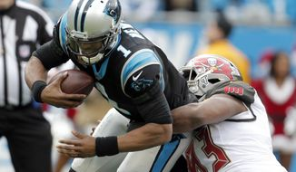 Carolina Panthers' Cam Newton (1) is sacked by Tampa Bay Buccaneers' Gerald McCoy (93) during the first half of an NFL football game in Charlotte, N.C., Sunday, Dec. 24, 2017. (AP Photo/Bob Leverone)