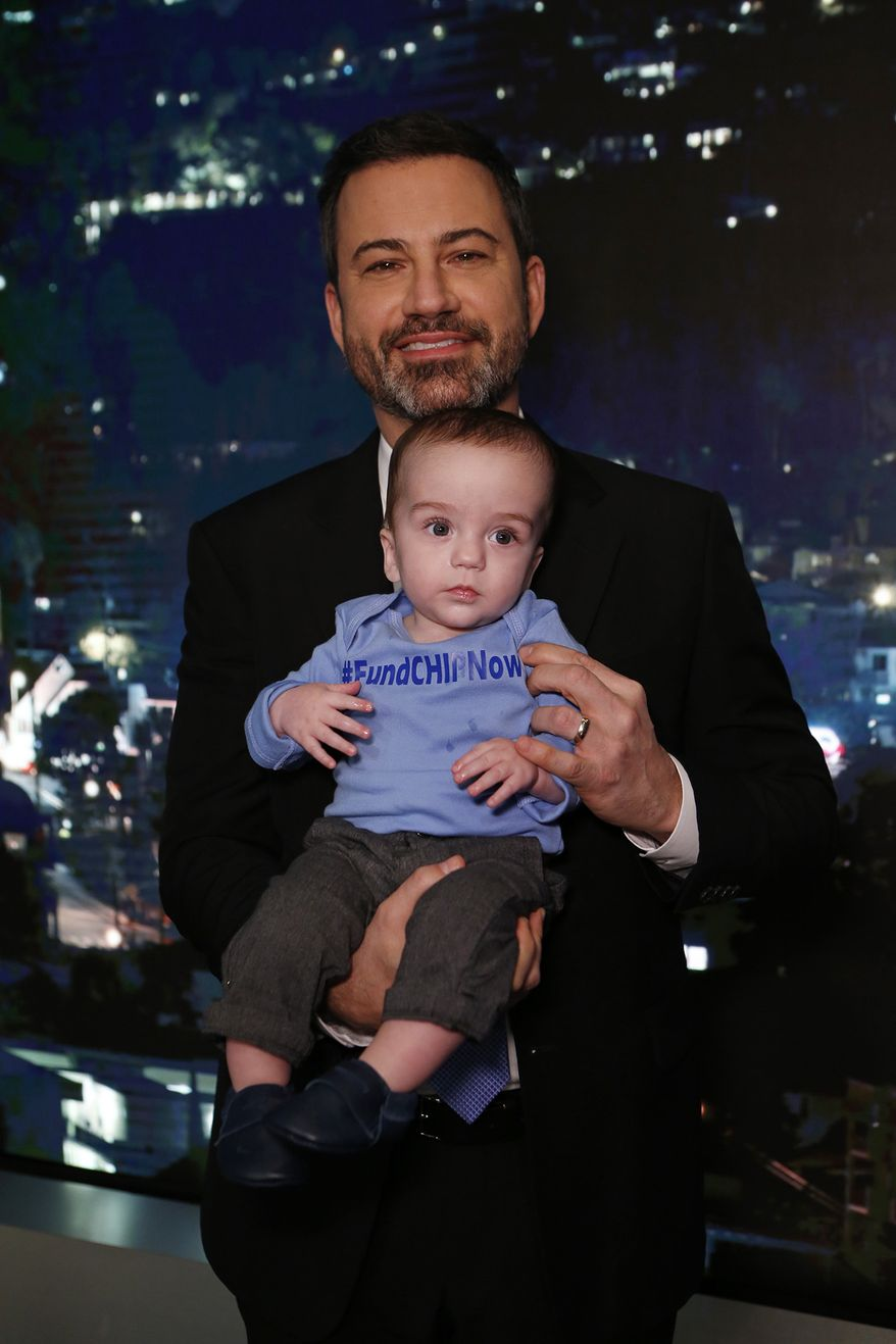 """This Dec. 11, 2017 image released by ABC shows host Jimmy Kimmel with his son Billy on the set of """"Jimmy Kimmel Live!"""" Kimmel held his baby son as he returned to his late-night show after a week off for the boy's heart surgery. Kimmel kept up his ardent advocacy Monday night, urging Congress to restore the Children's Health Insurance Program, which has been left unfunded and stuck in a political stalemate since September. (Randy Holmes/ABC via AP)"""