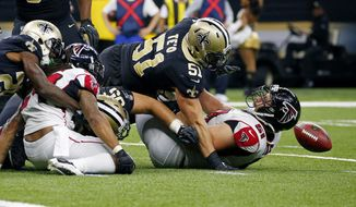 New Orleans Saints middle linebacker Manti Te'o (51) scrambles for a fumble by running back Devonta Freeman, left, over Atlanta Falcons center Alex Mack (51) in the second half of an NFL football game in New Orleans, Sunday, Dec. 24, 2017. (AP Photo/Butch Dill)