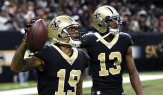 New Orleans Saints wide receiver Ted Ginn (19) celebrates his touchdown reception with wide receiver Michael Thomas (13) in the first half of an NFL football game against the Atlanta Falcons in New Orleans, Sunday, Dec. 24, 2017. (AP Photo/Bill Feig)