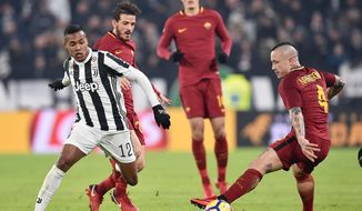 Juventus' Alex Sandro, left, and Roma's Radja Nainggolan vie for the ball during the Italian Serie A soccer match in Turin, Italy, Saturday, Dec. 23, 2017. (Alessandro Di Marco/ANSA via AP)
