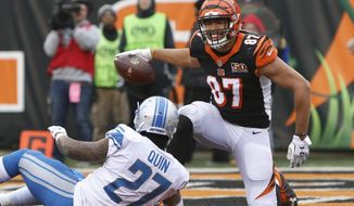 Cincinnati Bengals tight end C.J. Uzomah (87), defended by Detroit Lions free safety Glover Quin (27), smiles after catching a 1-yard pass for a touchdown during the second half of an NFL football game, Sunday, Dec. 24, 2017, in Cincinnati. (AP Photo/Frank Victores)