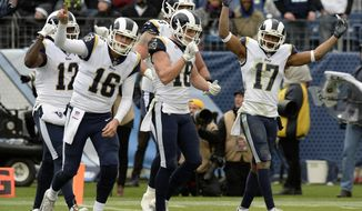Los Angeles Rams quarterback Jared Goff (16) and celebrates with wide receiver Cooper Kupp (18) after Kupp scored a touchdown against the Tennessee Titans in the second half of an NFL football game Sunday, Dec. 24, 2017, in Nashville, Tenn. At right is wide receiver Robert Woods (17). (AP Photo/Mark Zaleski)