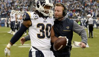 Los Angeles Rams running back Todd Gurley (30) is congratulated by head coach Sean McVay after Gurley scored a touchdown against the Tennessee Titans on an 80-yard pass reception in the first half of an NFL football game Sunday, Dec. 24, 2017, in Nashville, Tenn. (AP Photo/Mark Zaleski)