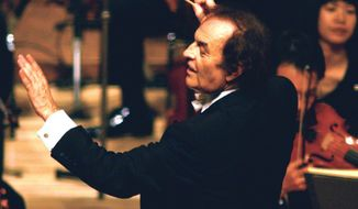 FILE - In this June 19, 2003, file photo, conductor Charles Dutoit performs with NHK Symphony Orchestra in Tokyo, Japan. A Canadian orchestra is launching an investigation in the wake of sexual assault allegations against Dutoit. A spokesman for the Montreal Symphony Orchestra, where Dutoit served as music director for nearly 25 years, confirmed Sunday, Dec. 24, 2017, he is the subject of a complaint. (Kyodo News via AP)