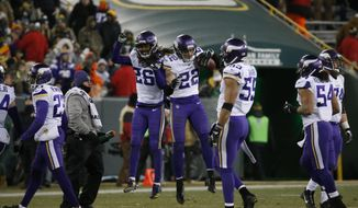 Minnesota Vikings' Harrison Smith (22) celebrates his second interception of the game during the fourth quarter of an NFL football game against the Green Bay Packers Saturday, Dec. 23, 2017, in Green Bay, Wis. The Vikings won 16-0. (AP Photo/Mike Roemer)