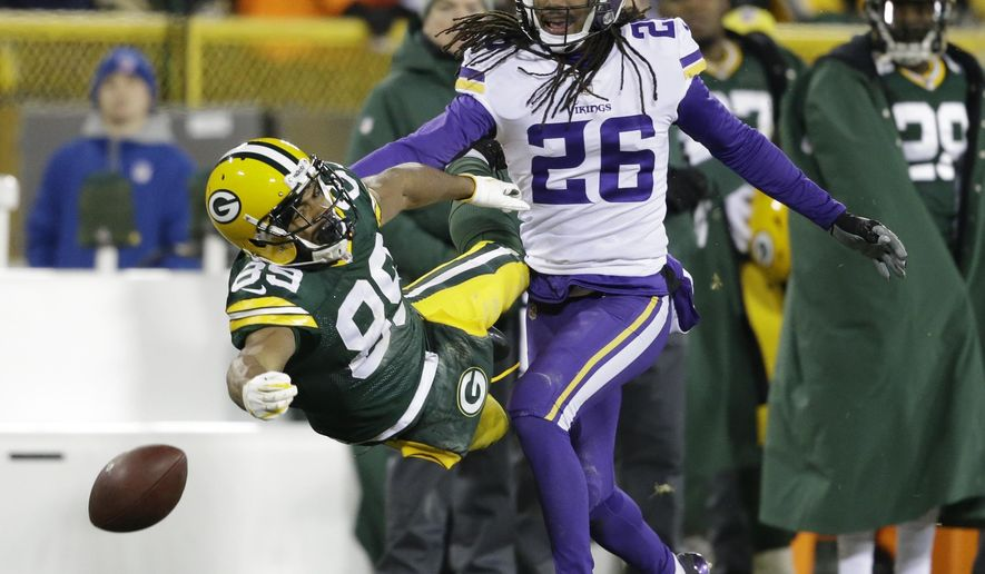 Minnesota Vikings' Trae Waynes breaks up a pass intended for Green Bay Packers' Michael Clark during the fourth quarter of an NFL football game Saturday, Dec. 23, 2017, in Green Bay, Wis. The Vikings won 16-0. (AP Photo/Jeffrey Phelps)