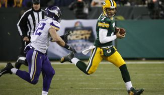 Green Bay Packers' Brett Hundley runs against Minnesota Vikings' Ben Gedeon during the second half of an NFL football game Saturday, Dec. 23, 2017, in Green Bay, Wis. (AP Photo/Mike Roemer)