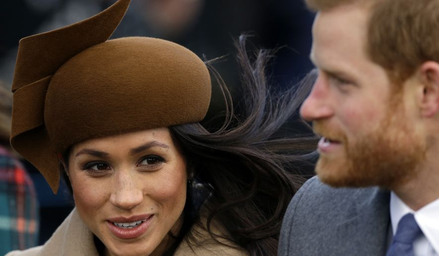 RESENDING TO PROVIDE AN ALTERNATIVE CROP OF SAN101- Prince Harry and his fiancee, Meghan Markle, arrive to attend the traditional Christmas Day service, at St. Mary Magdalene Church in Sandringham, England, Monday, Dec. 25, 2017. (AP Photo/Alastair Grant)