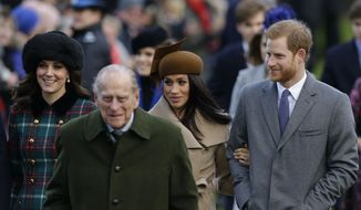 From left, Kate, Duchess of Cambridge, and Prince Philip, Meghan Markle, and Prince Harry arrive to the traditional Christmas Days service, at St. Mary Magdalene Church in Sandringham, England, Monday, Dec. 25, 2017. (AP Photo/Alastair Grant)