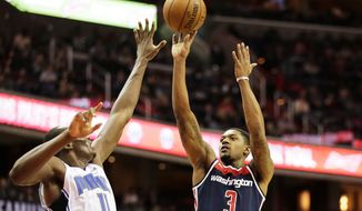 Washington Wizards guard Bradley Beal (3) shoots the ball against Orlando Magic center Bismack Biyombo (11) during an NBA basketball game Saturday, Dec. 23, 2017, in Washington. (AP Photo/Mark Tenally)