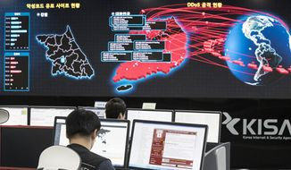 In this May 15, 2017, file photo, employees watch electronic boards monitoring possible ransomware cyberattacks at the Korea Internet and Security Agency in Seoul, South Korea. A North Korean ambassador to the United Nations says the U.S. claim that Pyongyang was behind the Wannacry ransomware attack earlier this year is a baseless provocation and demanded Washington back up its accusations with evidence. Pak Song Il told The Associated Press in a telephone interview from New York late Monday, Dec. 25, 2017, : If they are so sure, show us the evidence.(Yun Dong-jin/Yonhap via AP, File)