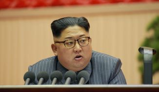 """In this Dec. 23, 2017, photo distributed on Dec. 24, 2017, by the North Korean government, North Korean leader Kim Jong-un addresses the conference of cell chairpersons of the ruling party in Pyongyang. North Korea on Sunday, Dec. 24, called the latest U.N. sanctions to target the country """"an act of war"""" that violates its sovereignty, and said it is a """"pipe dream"""" for the United States to think it will give up its nuclear weapons. (Korean Central News Agency/Korea News Service via AP) ** FILE **"""