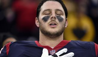 Houston Texans offensive guard David Quessenberry (77), a cancer survivor, listens during the National Anthem before an NFL football game against the Pittsburgh Steelers Monday, Dec. 25, 2017, in Houston. (AP Photo/Eric Christian Smith)