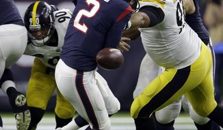 Pittsburgh Steelers defensive end Cameron Heyward (97) knocks the ball loose from Houston Texans quarterback T.J. Yates (2) during the first half of an NFL football game Monday, Dec. 25, 2017, in Houston. The Steelers recovered the fumble. (AP Photo/Michael Wyke)