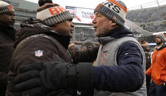 Cleveland Browns head coach Hue Jackson, left, talks with Chicago Bears head coach John Fox after an NFL football game in Chicago, Sunday, Dec. 24, 2017. Chicago won 20-3. (AP Photo/Nam Y. Huh)