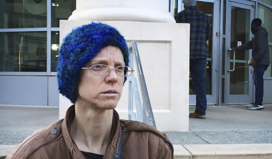 In this Dec. 14, 2017, photo, Adele MacLean talks to reporters outside Atlanta's municipal court after her ticket for refusing to stop feeding the homeless in an Atlanta park was dropped. Volunteers who feed the homeless in public places say they're providing a needed service. But city governments and some advocates say their well-meaning efforts can hinder long-term solutions and raise sanitation concerns. (AP Photo/Kate Brumback)