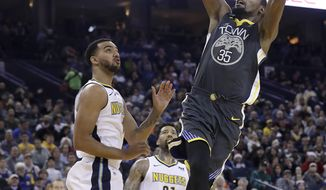 Golden State Warriors forward Kevin Durant (35) shoots over Denver Nuggets forward Trey Lyles during the second half of an NBA basketball game in Oakland, Calif., Saturday, Dec. 23, 2017. The Nuggets won 96-81. (AP Photo/Jeff Chiu)