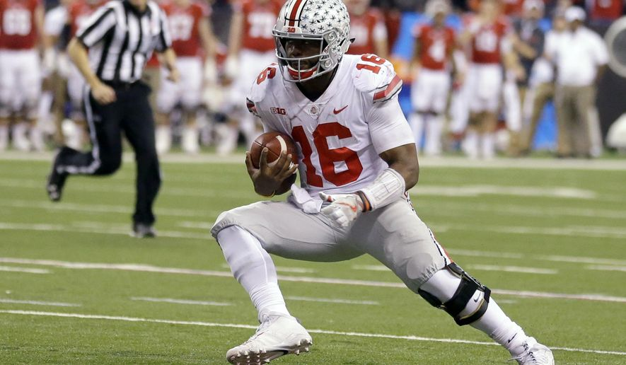 FILE - In this Dec. 2, 2017, file photo, Ohio State quarterback J.T. Barrett runs with the ball during the second half of the Big Ten championship NCAA college football game against Wisconsin in Indianapolis. Next fall, seven fifth-year Ohio State seniors are departing, including four-year starting quarterback Barrett. (AP Photo/Michael Conroy, File)