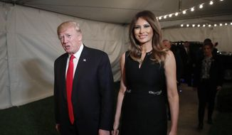 President Donald Trump and first lady Melania arrive for Christmas Eve service at the Church of Bethesda-by-the-Sea in West Palm Beach, Fla., Sunday, Dec. 24, 2017. (AP Photo/Carolyn Kaster)