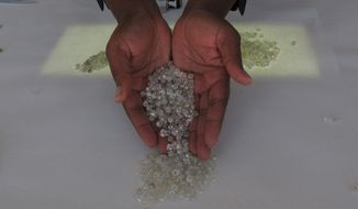 Kimberley Process authorities have sought to implement a storage and marking system to address difficulty that officials are having in preventing blood diamonds from blending with legal gems. (Associated Press/File)