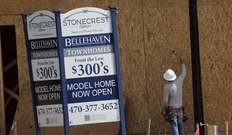In this Tuesday, May 16, 2017, file photo, a construction worker continues work on new town homes under construction in Woodstock, Ga. The Standard & Poor's CoreLogic Case-Shiller home price index, which tracks the value of homes in 20 major U.S. metropolitan areas, is due out Tuesday, Dec. 26, 2017. (AP Photo/John Bazemore, File)
