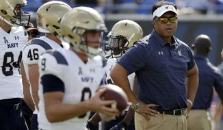 File- This Oct. 14, 2017, file photo shows Navy head coach Ken Niumatalolo watching as players warm up before an NCAA college football game, in Memphis, Tenn. Navy (6-6) will be making its 14th bowl appearance over the last 15 years. But its been an up and down season for the Midshipmen, who have lost six of seven following a 5-0 start and are coming off a disheartening 14-13 loss to Army. Navy desperately wants to avoid being saddled with a losing record for the first time since 2011. Playing at home should help. From a preparation standpoint, you cant beat this, Niumatalolo said. Youve got everything like you would in a normal game. (AP Photo/Mark Humphrey, File)