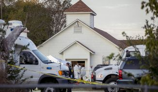 FILE - In this Nov. 5, 2017, file photo, investigators work at the scene of a deadly shooting at the First Baptist Church in Sutherland Springs, Texas. New York City, San Francisco and Philadelphia filed a federal lawsuit Tuesday, Dec. 26, against the Defense Department, saying many service members who are disqualified from gun ownership weren't reported to the national background check system. A Defense Department failure allowed a disgraced former Air Force member to buy a high-powered rifle and shoot 26 people to death at the church. (Jay Janner/The San Antonio Express-News via AP, File)
