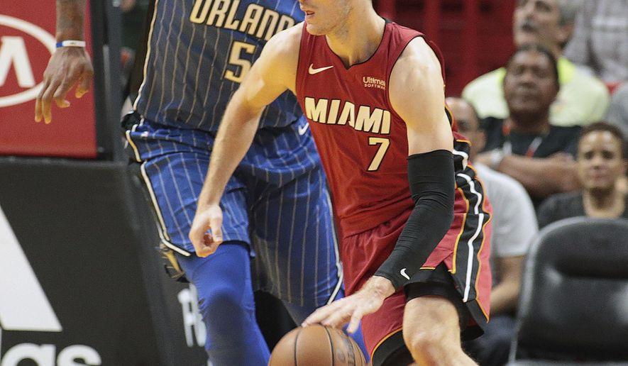 Orlando Magic forward Marreese Speights (5) defends against Miami Heat guard Goran Dragic (7) during the first half of an NBA basketball game, Tuesday, Dec. 26, 2017, in Miami. (AP Photo/Joel Auerbach)