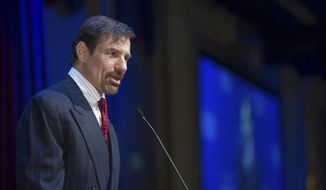 In this May 30, 2015, file photo, Henry T. Nicholas III talks during the Nicholas Academic Center's 2015 Graduation ceremony at the Disneyland Hotel in Anaheim, Calif. After his sister was murdered, Nichols III spent millions to enshrine a so-called bill of rights for crime victims into California's constitution. Now, he is taking his effort into the nation's heartland, including Oklahoma, spending millions on teams of lobbyists and PR companies to influence legislatures and amend state constitutions all over the country. (Eric Reed/AP Images for Nicholas Academic Centers) **FILE**