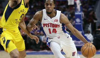 Detroit Pistons guard Ish Smith (14) drives to the basket against Indiana Pacers guard Cory Joseph (6) during the first half of an NBA basketball game, Tuesday, Dec. 26, 2017, in Detroit. (AP Photo/Duane Burleson)