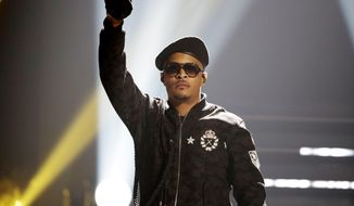 FILE - In this Sept. 17, 2016, file photo, T.I. performs during the BET Hip Hop Awards in Atlanta. Rapper T.I. spent Christmas eve spreading holiday cheer among some single mothers, helping them with their last-minute shopping for gifts. In a video T.I. posted on social media, the Grammy-winning artist entered an Atlanta-area Target on Sunday, Dec. 24, 2017, and called for all single mothers present to follow him. He strolled through the store alongside several mothers, went to the cash register with them and then paid for their Christmas presents. (AP Photo/David Goldman, File)