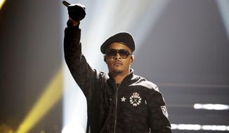 In this Sept. 17, 2016, file photo, T.I. performs during the BET Hip Hop Awards in Atlanta. Rapper T.I. spent Christmas eve spreading holiday cheer among some single mothers, helping them with their last-minute shopping for gifts. In a video T.I. posted on social media, the Grammy-winning artist entered an Atlanta-area Target on Sunday, Dec. 24, 2017, and called for all single mothers present to follow him. He strolled through the store alongside several mothers, went to the cash register with them and then paid for their Christmas presents. (AP Photo/David Goldman, File)