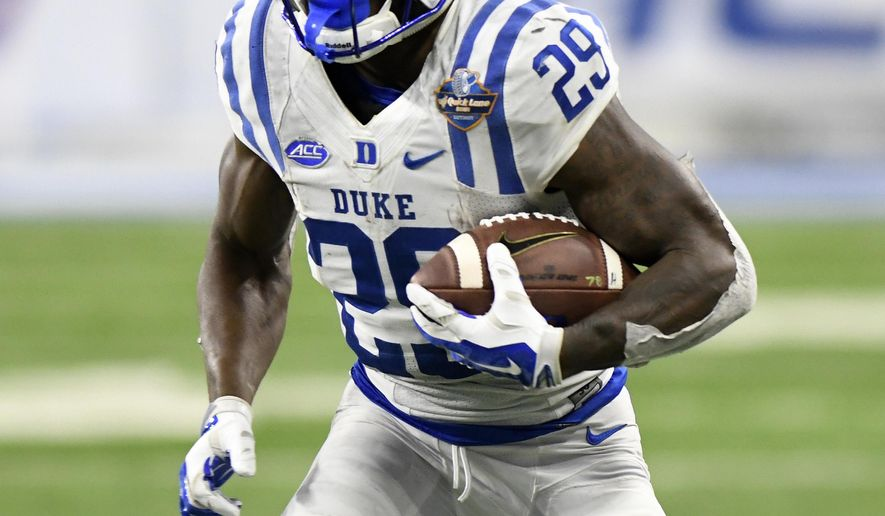 Duke running back Shaun Wilson (29) runs against Northern Illinois during the second quarter of the Quick Lane Bowl NCAA college football game, Tuesday, Dec. 26, 2017, in Detroit. (AP Photo/Jose Juarez)