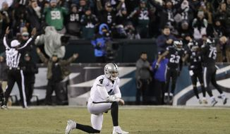 Oakland Raiders' Derek Carr reacts after throwing an interception during the second half of an NFL football game against the Philadelphia Eagles, Monday, Dec. 25, 2017, in Philadelphia. (AP Photo/Chris Szagola)