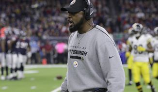 Pittsburgh Steelers coach Mike Tomlin yells on the sidelines during the second half of an NFL football game against the Houston Texans Monday, Dec. 25, 2017, in Houston. (AP Photo/Michael Wyke)