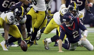 Pittsburgh Steelers outside linebacker Bud Dupree (48) recovers a fumble by Houston Texans quarterback T.J. Yates (2) during the first half of an NFL football game Monday, Dec. 25, 2017, in Houston. (AP Photo/Michael Wyke)