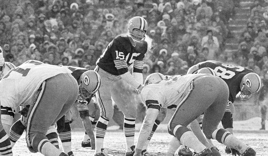 FILE - In this Dec. 31, 1967, file photo, Green Bay Packers quarterback Bart Starr calls signals in bitter cold as he led the Packers to a win over the Dallas Cowboys in Green Bay, Wisc. Fifty years later, players from the Packers and Cowboys still shiver from memories of the bitter cold of a game that would become known as the Ice Bowl. (AP Photo/File)