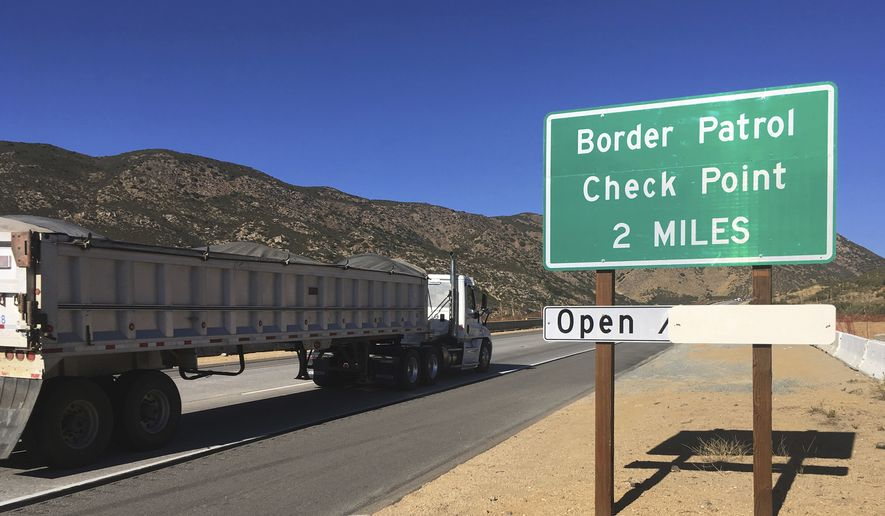 In this Thursday, Dec. 14, 2017 photo, a sign warns of the upcoming California Pine Valley checkpoint, on the main route from Arizona to San Diego. (AP Photo/Elliot Spagat) **FILE**