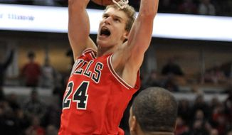 Chicago Bulls' Lauri Markkanen (24), of Finland, dunks during the final minutes of the second half of an NBA basketball game against the New York Knicks, Wednesday, Dec. 27, 2017, in Chicago. (AP Photo/Paul Beaty)